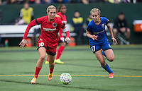 Seattle, WA - Saturday, May 14, 2016: Portland Thorns FC midfielder Allie Long (10) dribbles the ball up the field as Seattle Reign FC midfielder Beverly Yanez (17) defends during the first half. The Portland Thorns FC and the Seattle Reign FC played to a 1-1 tie during a regular season National Women's Soccer League (NWSL) match at Memorial Stadium.