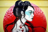 Titolo: Okurimono Artista Fin DAC, irlandese<br /> Title: Okurimono, Artist Fin DAC<br /> Street artist di origini irlandesi, londinese di adozione, dipinge esclusivamente soggetti femminili, soprattutto donne asiatiche, restituendone con estrema cura i particolari, abiti, capelli, vestiti.<br /> Roma 01-02-2015 Street Art a Roma. In vari quartieri di Roma e' fiorita la Street Art, con splendidi murales che hanno lo scopo di raccontare delle storie della citta', di commemorare dei momenti importanti, o semplicemente di interpretarla.<br /> Street Art in Rome. Very important writers  painted Murales in various districts of Rome to tell stories about the city, to commemorate important moments, to embellish the quarter or simply to portray it.  <br /> Photo Samantha Zucchi Insidefoto