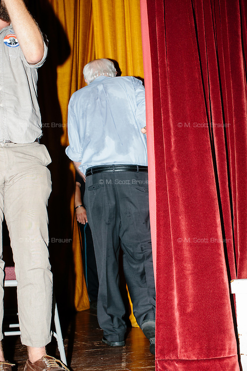 Vermont senator and Democratic presidential candidate Bernie Sanders leaves the stage after speaking at a campaign event at the Littleton Opera House in Littleton, New Hampshire.