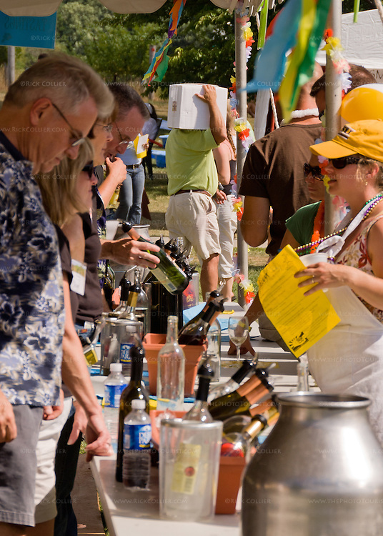 Volunteers work the serving line tasting bar at Breaux Vineyards' annual Key West Fest.