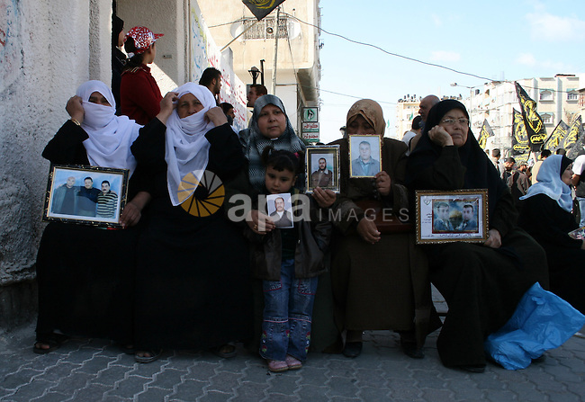 Palestinians hold pictures of their relatives who held in Israeli Jails, During a weekly protest calling for their release, in front of the Red Cross headquarters in Gaza City.
