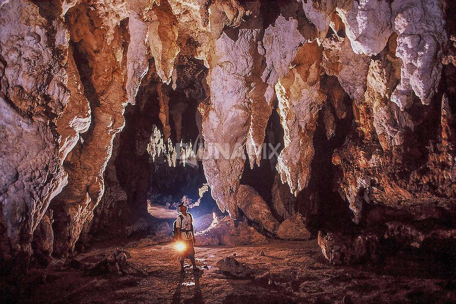 Large stalactites decorate Tengkorak (Skull) Cave in the Marang Mountains, Sangkulirang, East Kalimantan. Many  Sangkulirang caves harbor archeological remains. Handprints adorn even high, inaccessible nooks on the cave ceiling.