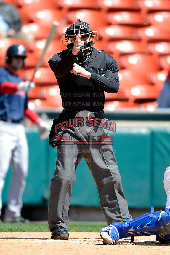 Umpire Ian Fazio makes a call during the first game of a doubleheader between the Buffalo Bisons and Pawtucket Red Sox on April 25, 2013 at Coca-Cola Field in Buffalo, New York.  Pawtucket defeated Buffalo 8-3.  (Mike Janes/Four Seam Images)