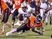 Virginia running back Kevin Parks (25) scores a touchdown in front of Brigham Young linebacker Alani Fua (5) during the fourth quarter of the game in Charlottesville, Va. Virginia defeated Brigham Young 19-16. Photo/Andrew Shurtleff