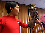 Juan Brena, 12, holds Archimedes, a great horned owl, during a Wild Things presentation at the Carson City Library, in Carson City, Nev., on Wednesday, July 30, 2014.<br /> Photo by Cathleen Allison
