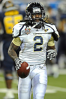 26 December 2010:  FIU defensive back Junior Mertile (2) leaves the field with a souvenir, the ball he intercepted the third quarter as the FIU Golden Panthers defeated the University of Toledo Rockets, 34-32, to win the 2010 Little Caesars Pizza Bowl at Ford Field in Detroit, Michigan.