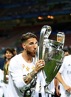 Calcio, finale di Champions League: Real Madrid vs Atletico Madrid. Stadio San Siro, Milano, 28 maggio 2016.<br /> Real Madrid&rsquo;s Sergio Ramos kisses the Champions League trophy at the end of the final match against Atletico Madrid, at Milan's San Siro stadium, 28 May 2016. Real Madrid won 5-4 on penalties after the game ended 1-1.<br /> UPDATE IMAGES PRESS/Isabella Bonotto
