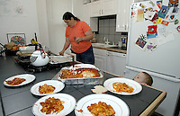 Foster parent Bobbi Pedersen, left, prepares dinner as foster child Christopher Gray gets a sneak peek at what's cooking Monday June 16, 2003 in Columbus, Ohio.<br />