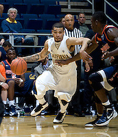 Justin Cobbs of California dribbles the ball away from Pepperdine defender during the game at Haas Pavilion in Berkeley, California on November 13th, 2012.  California defeated Pepperdine, 79-62.