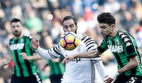 Calcio, Serie A: Sassuolo vs Juventus. Reggio Emilia, Mapei Stadium, 29 gennaio 2017. <br /> Juventus&rsquo; Gonzalo Higuain, left, is challenged by Sassuolo's Luca Antei during the Italian Serie A football match between Sassuolo and Juventus at Reggio Emilia's Mapei stadium, 29 January 2017.<br /> UPDATE IMAGES PRESS/Isabella Bonotto