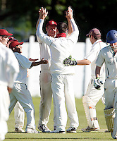 Brad Sculley (facing) high fives Darren Eckford after Eckford dismissed an Enfield player during the Middlesex County Cricket League Division Two game between North Middlesex and Enfield at Park Road, Crouch End, London on Sat May 22, 2010