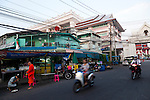Thewet Market, Bangkok, Thailand. Monks from a nearby temple out collecting alms at dawn.