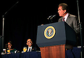 Former NASCAR race car driver Darrell L. Waltrip delivers the keynote address during the National Prayer Breakfast at the Washington Hilton Hotel in Washington, D.C. on February 5, 2015.  U.S. and international leaders from different parties and religions gather annually at this event for an hour devoted to faith and prayer.  First lady Michelle Obama and United States President Barack Obama look on from left.<br /> Credit: Dennis Brack / Pool via CNP