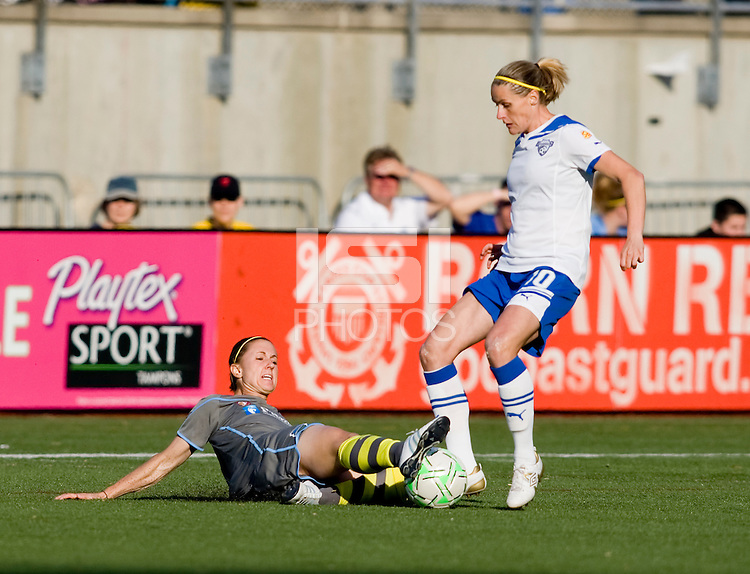 Leigh Ann Robinson (7) of the Philadelphia Independence tackles the ball away from Kelly Smith (10) of the Boston Breakers during the game at Quick Stadium in Chester, PA.  The Philadelphia Independence defeated the Boston Breakers, 2-0.