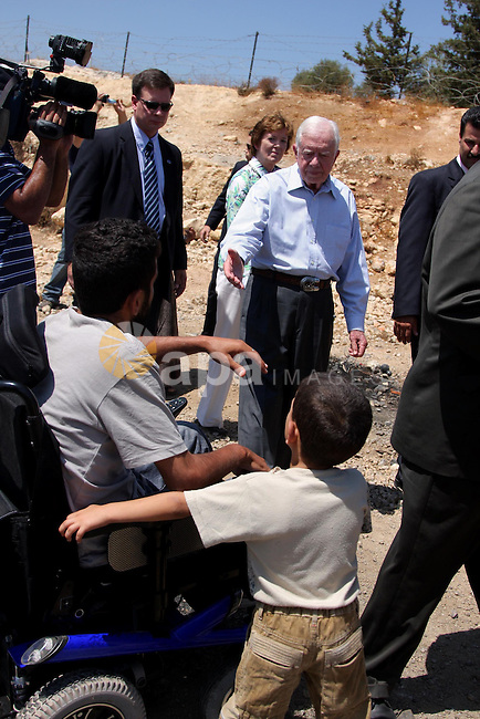 """The Elders, a group of eminent global leaders And Former U.S. President Jimmy Carter stands in front of the controversial Israeli barrier during a visit to the West Bank village of Bilin near Ramallah August 27, 2009. The delegation from the group known as """"The Elders"""" includes former US president Jimmy Carter, South African Archbishop Desmond Tutu and Richard Branson, the British founder and chief executive of the multi-national Virgin Group. Photo By Issam Rimawi"""
