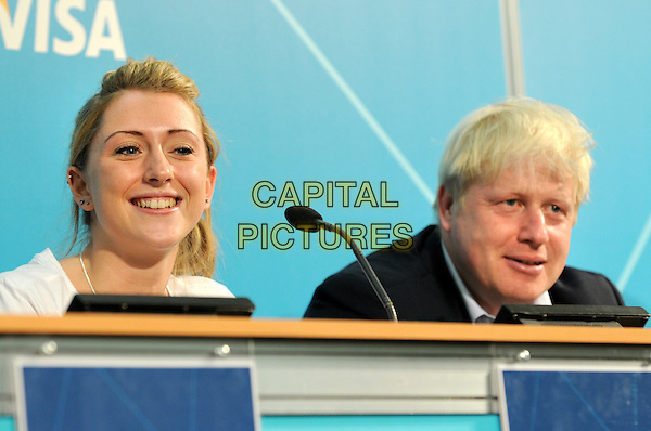 Boris Johnson and Laura Trott.Mayor Of London's Cycling Press Conference, London Media Centre, London, England..August 10th 2012.headshot portrait black white microphone table sitting .CAP/BK.PP.©Bob Kent/PP/Capital Pictures.