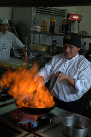 Chef prepares sauce at Restaurante Caplina in Lima Peru