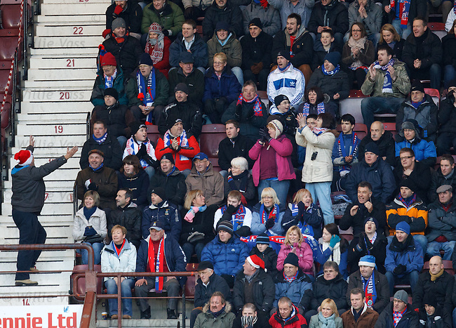 Santa from Inverness leads the Caley Thistle fans in a carol singing sessiuon during the match