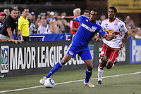 Teal Bunbury (blue), Roy Miller...Kansas City Wizards were defeated 3-0 by New York Red Bulls at Community America Ballpark, Kansas City, Kansas.