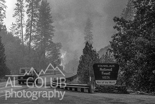 September 3, 1987 Buck Meadows, California -- Stanislaus Complex Fire -- Active fire coming up from a Tuolumne River canyon threatens to jump Highway 120 near Rim of the World overlook. The Stanislaus Complex Fire consumed 28 structures and 145,980 acres.  One US Forest Service firefighter, David Ross Erickson, died from a tree-felling accident.