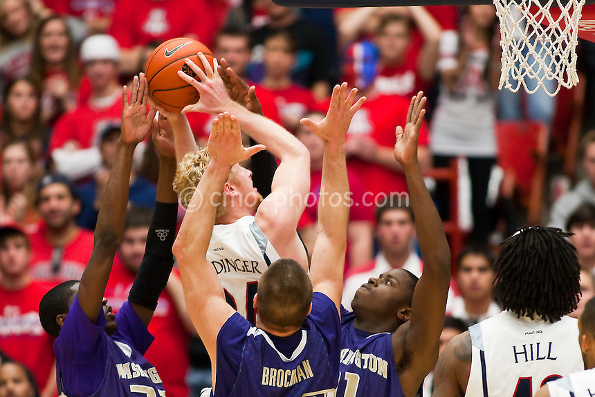 Jan 29, 2009; Tucson, AZ, USA; Arizona Wildcats forward Chase Budinger (34) goes up for a shot between three Washington Huskies defenders in the first half of a game at the McKale Center.  The Wildcats won the game 106-97.