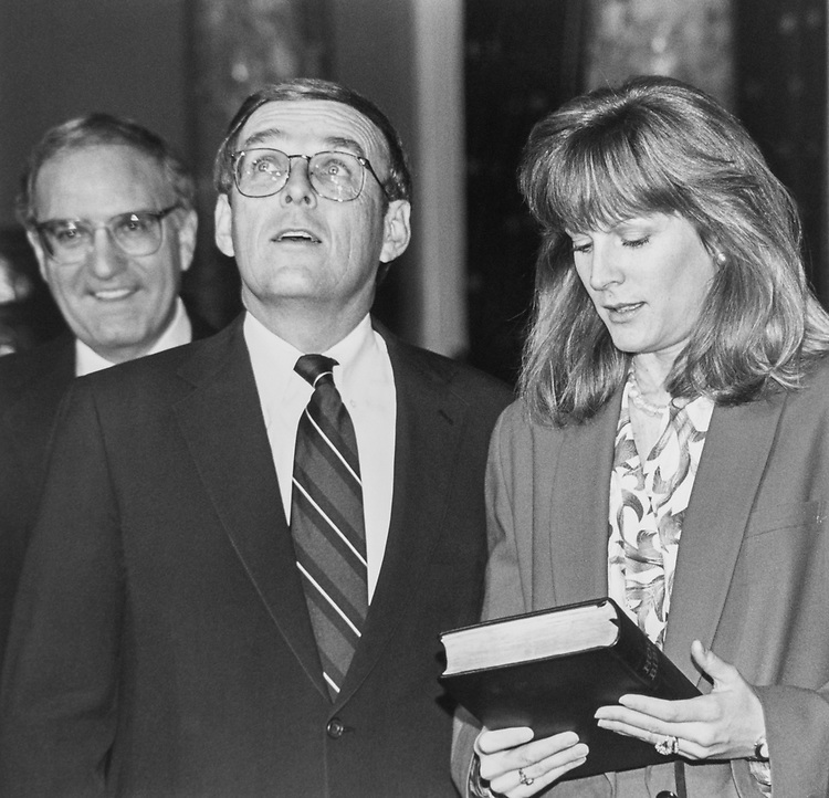 Just after Sen. Byron Dorgan, D-N.D., was sworn in in old Senate Chambers. With him were his Mrs. Bundick, Sen. George J. Mitchell, D-Maine, wife Kimberly Dorgan and Sen. Byrd on Dec. 15, 1992. (Photo by Maureen Keating/CQ Roll Call via Getty Images)