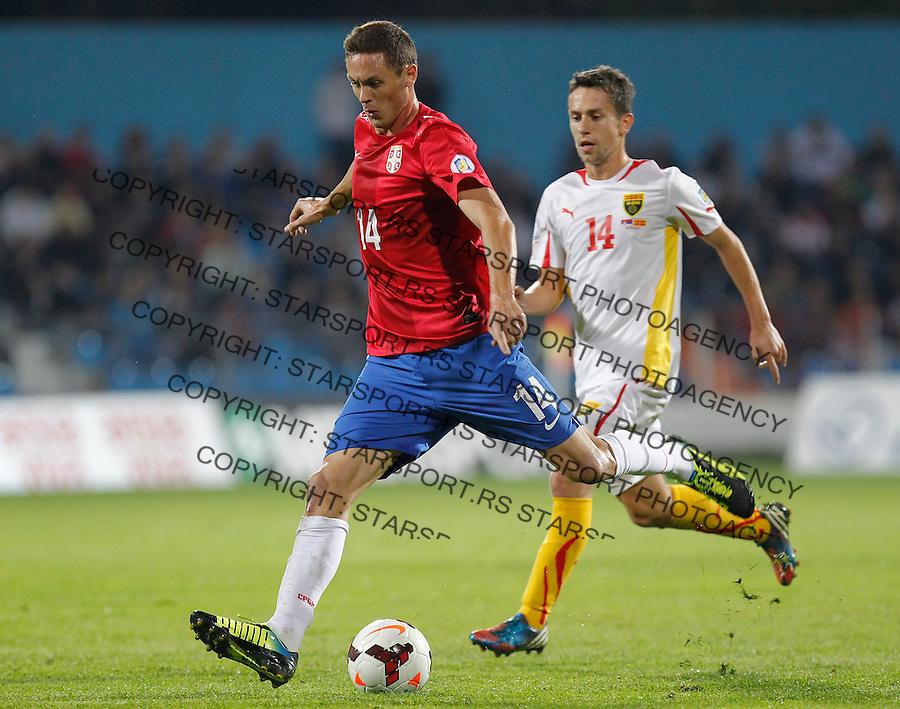 Fudbal Soccer<br /> World Cup 2014 qualifiers match<br /> Serbia v Macedonia<br /> Nemanja Matic (L) and Predrag Randjelovic (R)<br /> Jagodina, 15.10.2013.<br /> foto: Srdjan Stevanovic/Starsportphoto &copy;