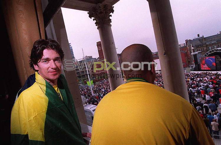 Pix: Ben Duffy/SWpix.com. Soccer, World Cup. England v Brazil. 21/06/2002..COPYWRIGHT PICTURE>>SIMON WILKINSON>>01943 436649>>..Futebol de Salao, Simon Clifford watches the game in Millenium Square from the Lord Mayors office in the Civic Centre in Leeds