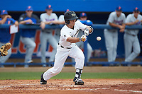 Stuart Fairchild (4) of the Wake Forest Demon Deacons bunts the baseball against the Florida Gators in the completion of Game Two of the Gainesville Super Regional of the 2017 College World Series at Alfred McKethan Stadium at Perry Field on June 12, 2017 in Gainesville, Florida. The Demon Deacons walked off the Gators 8-6 in 11 innings. (Brian Westerholt/Four Seam Images)