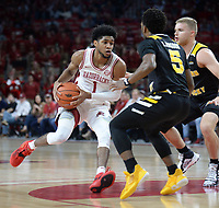 NWA Democrat-Gazette/ANDY SHUPE<br /> Arkansas guard Isaiah Joe (1) drives to the basket Saturday, Nov. 30, 2019, as Northern Kentucky guards Bryson Langdon (5) and Tyler Sharpe defend during the first half of play in Bud Walton Arena. Visit nwadg.com/photos to see more photographs from the game.