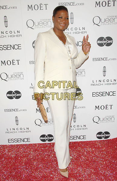 QUEEN LATIFAH.The Third Annual ESSENCE Black Women In Hollywood Luncheon held at The Beverly Hills Hotel in Beverly Hills, California, USA..March 4th, 2010                                                                    .full length white cream suit trousers jacket hand v peace sign beige clutch bag .CAP/RKE/DVS.©DVS/RockinExposures/Capital Pictures.