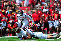RB Brandon Ross of the Terrapins is tackled after getting first down. Maryland defeated Richmond 50-21 during home season opener at the Byrd Stadium in College Park, MD on Saturday, September 5, 2015.  Alan P. Santos/DC Sports Box