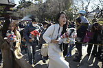 TOKYO, JAPAN - FEBRUARY 3: People carry their beloved pets to pray for good health in Zojoji Temple in Tokyo on Feb. 3, 2019 during the annual mamemaki or the bean-throwing ceremony. The ritual ceremony is observed at temples and shrines throughout the country, is believed by Japanese to drive out the demons of misfortune and it is considered as the beginning of spring. (Photo: Richard Atrero de Guzman/Aflo)