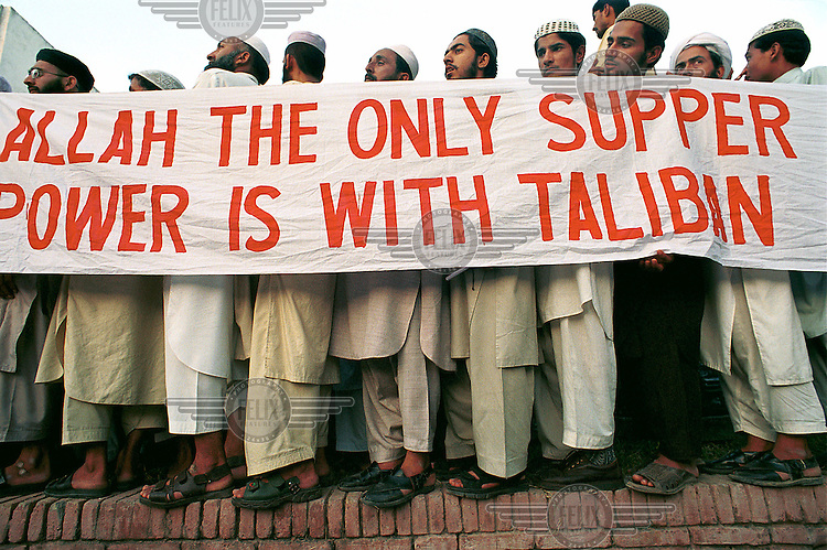 © Piers Benatar / Panos Pictures..Islamabad, Pakistan. September 2001...'Allah the only Super Power is with Taliban': Muslims hold up a banner at a demonstration in support of the Taliban regime in neighbouring Afghanistan. Tensions were high in the wake of the September 11th terrorist attacks on the United States. Pakistan's President Musharraf angered many of his countrymen by joining America's alliance against terrorism.
