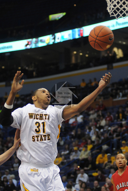 March 4,  2011          Wichita State Shockers forward/center J.T. Durley (31) goes in for a layup in the second half. Wichita State defeated Bradley University 70-56 in the third quarterfinal game of the NCAA Missouri Valley Conference Men's Basketball Tournament on Friday March 4, 2011 at the Scottrade Center in downtown St. Louis.