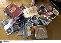Writer John Moriarty picks a book from his large collection at his home in Coolies, Muckross, Killarney in 2006.<br /> Picture by Don MacMonagle