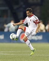 D.C. United forward Carlos Ruiz (20) redirects a passed ball. In a Major League Soccer (MLS) match, the New England Revolution (blue) tied D.C. United (white), 0-0, at Gillette Stadium on June 8, 2013.