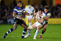 Phil Dollman of Exeter Chiefs is tackled by Anthony Watson of Bath Rugby. Aviva Premiership match, between Bath Rugby and Exeter Chiefs on December 31, 2016 at the Recreation Ground in Bath, England. Photo by: Patrick Khachfe / Onside Images