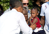 United States President Barack Obama greets Zoey Komongnan during a remembrance ceremony for the 12th anniversary of the 9/11 terrorist attacks, at the Pentagon on September 11, 2013 in Arlington, Virginia. <br /> Credit: Kevin Dietsch / Pool via CNP