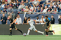 FOXBOROUGH, MA - AUGUST 3: Carles Gil #22 of New England Revolution on the attack during a game between Los Angeles FC and New England Revolution at Gillette Stadium on August 3, 2019 in Foxborough, Massachusetts.