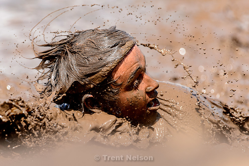 Trent Nelson     The Salt Lake Tribune<br /> Runners get dirty at the Dirty Dash, held at Soldier Hollow, Saturday June 6, 2015.
