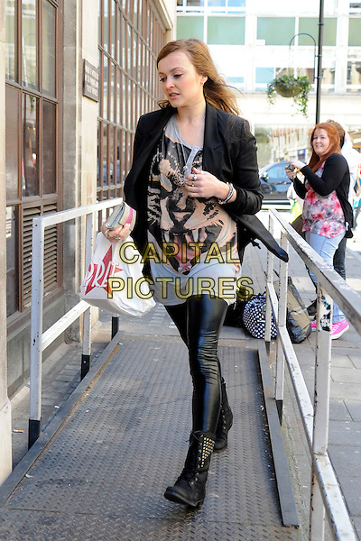FEARNE COTTON.Spotted at BBC Radio 1, London, England..April 21st, 2010.full length black blazer pret a manger plastic bag leather pvc leggings trousers boots biker grey gray tiger animal print top bracelets studs studded .CAP/IA.©Ian Allis/Capital Pictures.