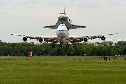 Space Shuttle Discovery arrives at Washington Dulles International Airport in Virginia after its final flight from the Kennedy Space Center in Florida on Tuesday, April 17, 2012.  Discovery will be on permanent display at the  Smithsonian Institution's Steven F. Udvar-Hazy Center in Chantilly, Virginia..Credit: Ron Sachs / CNP.(RESTRICTION: NO New York or New Jersey Newspapers or newspapers within a 75 mile radius of New York City)