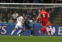 Pictured: Michel Vorm goalkeeper for Swansea (2nd L) saves the ball from a Liverpool shot.<br /> Monday 16 September 2013<br /> Re: Barclay's Premier League, Swansea City FC v Liverpool at the Liberty Stadium, south Wales.