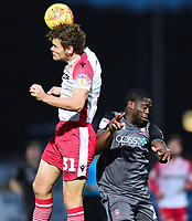 Stevenage's Ben Nugent clears under pressure from Lincoln City's John Akinde<br /> <br /> Photographer Andrew Vaughan/CameraSport<br /> <br /> The EFL Sky Bet League Two - Stevenage v Lincoln City - Saturday 8th December 2018 - The Lamex Stadium - Stevenage<br /> <br /> World Copyright © 2018 CameraSport. All rights reserved. 43 Linden Ave. Countesthorpe. Leicester. England. LE8 5PG - Tel: +44 (0) 116 277 4147 - admin@camerasport.com - www.camerasport.com