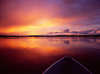 Sunset on nothern Canadian lake after a thunderstorm.<br /> Portal Lake