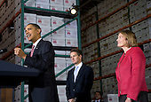 Landover, MD - October 21, 2009 -- United States President Barack Obama announces a package of lending initiatives to increase the availability of loans to small businesses at a document archiving company in suburban Maryland. He is joined by Treasury Secretary Timothy Geithner, left, and Small Business Administration Administrator Karen Mills, right. .Credit: Kristoffer Tripplaar / Pool via CNP