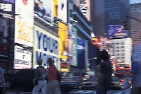 People walking in front of Times Square billboard advertisments<br />