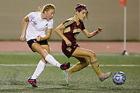 Penn's Lauren Cernak (6) takes a shot on goal in front of Brebeuf Jesuit's Lizzy Case during the IHSAA Class 2A Girls Soccer State Championship Game on Saturday, Oct. 29, 2016, at Carroll Stadium in Indianapolis. Special to the Tribune/JAMES BROSHER