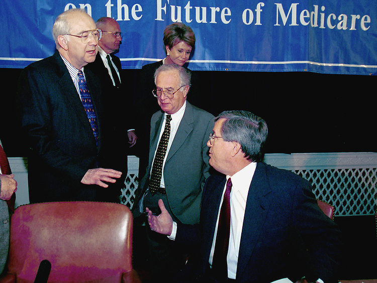 3-17-99.MEDICARE COMISSION MEETING--Phil Gramm, R-TEXAS, Stuart Altman and Bill Thomas, R-Calif., talk before the start of the National Bipartison Commission on the future of Medicare..CONGRESSIONAL QUARTERLY PHOTO BY DOUGLAS GRAHAM